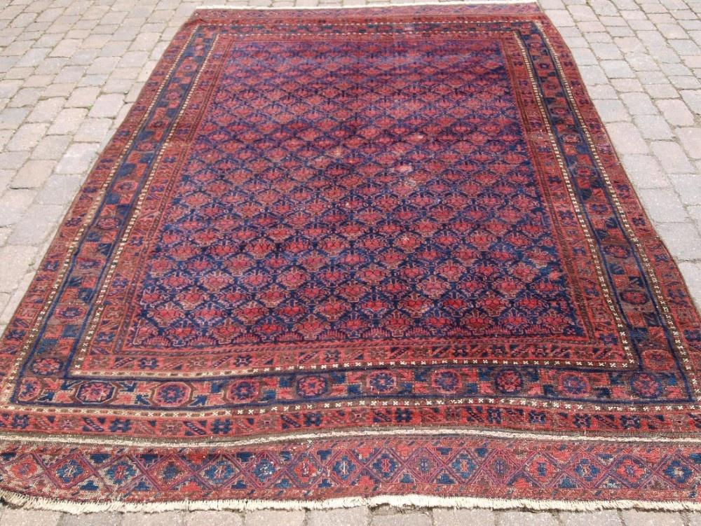 antique timuri baluch main carpet excellent colour unusual shrub design 2nd half 19th century