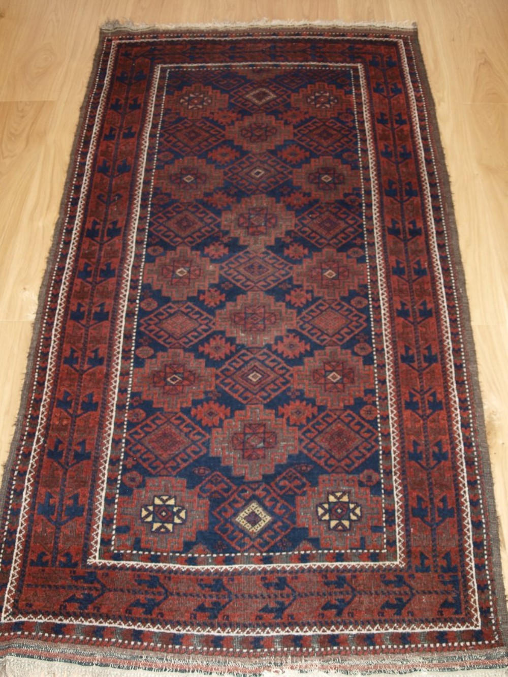 antique baluch rug with repeat design heavy corrosion circa 1900