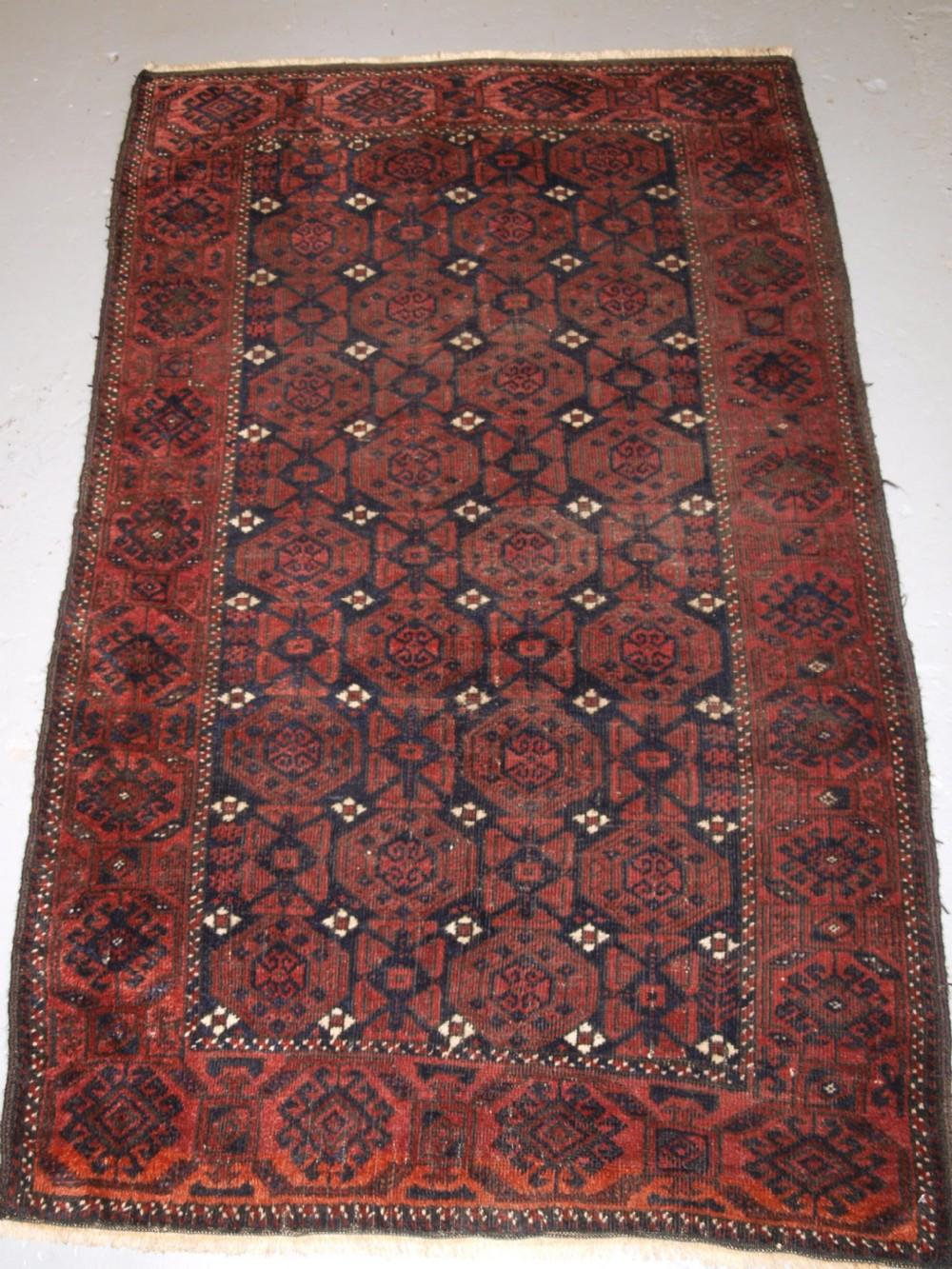 antique baluch rug with repeat lattice design white flowers circa 1900