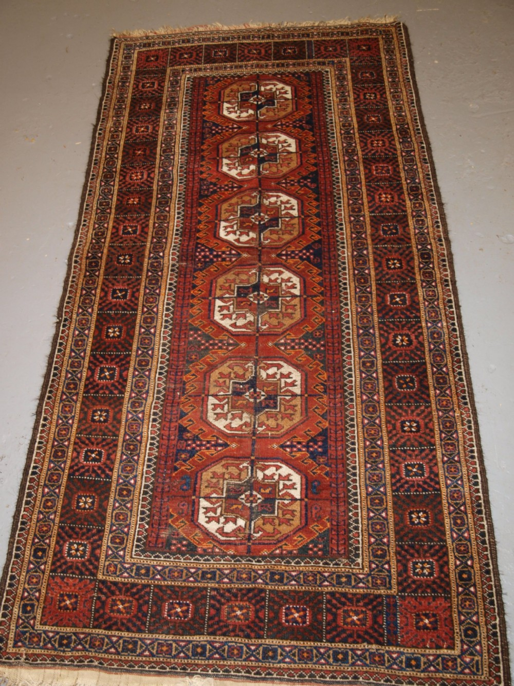 antique persian baluch rug by the mahdad khani tribe large tekke guls circa 1900