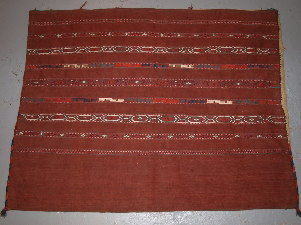 antique tekke turkmen banded flat woven chuval complete with back circa 1900