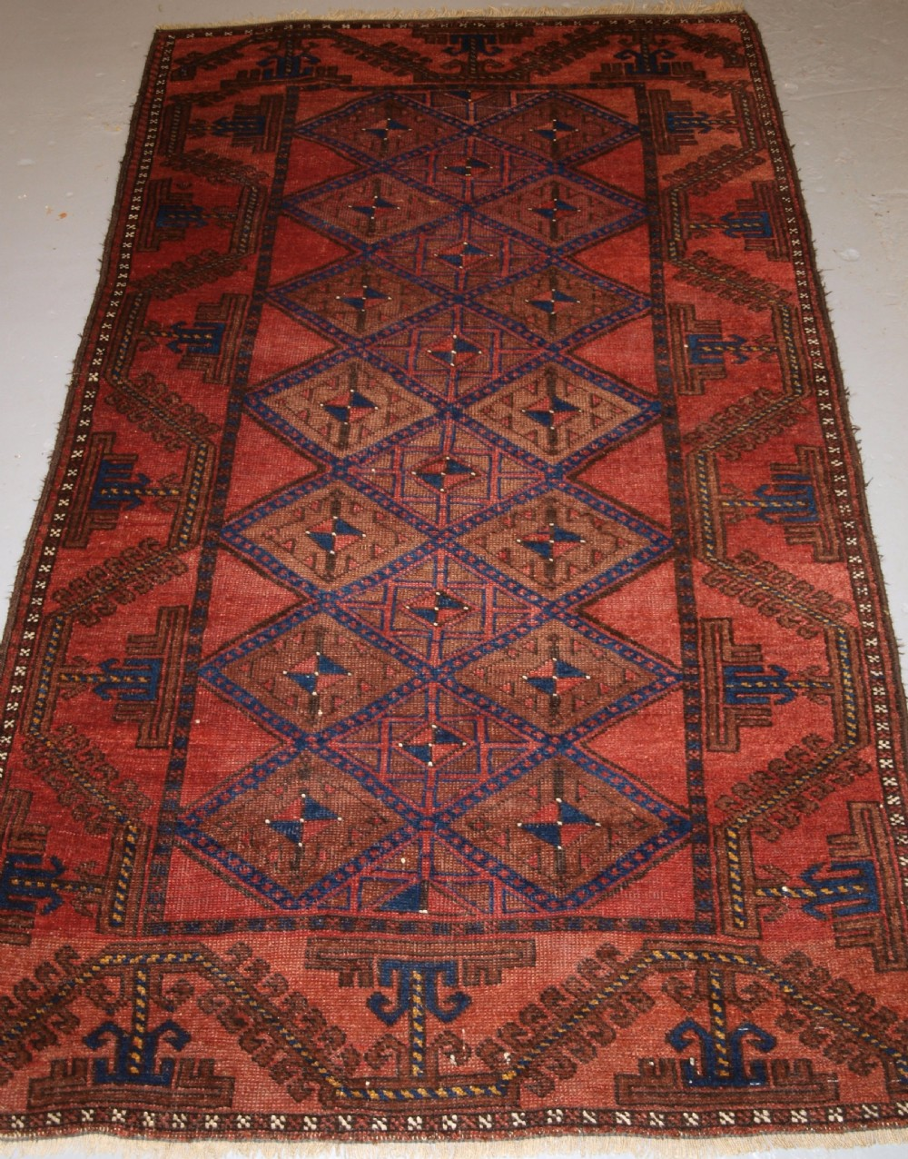 antique afghan rug of baluch lattice design warm colours circa 190020