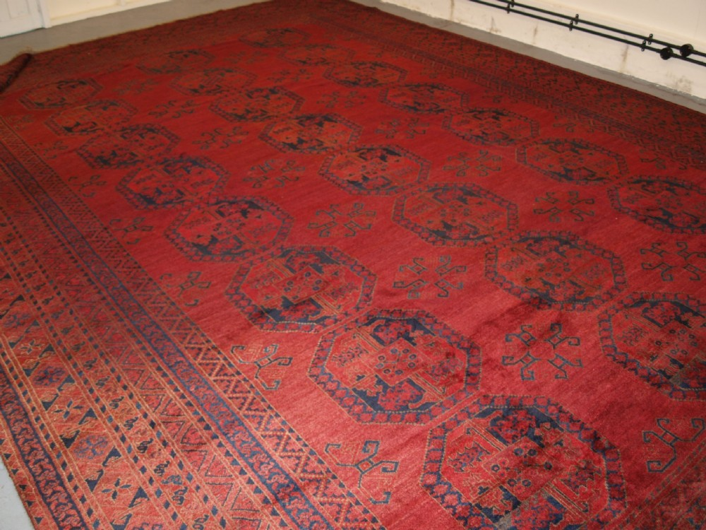 antique afghan ersari carpet of very large size with superb rose madder colour circa 1900