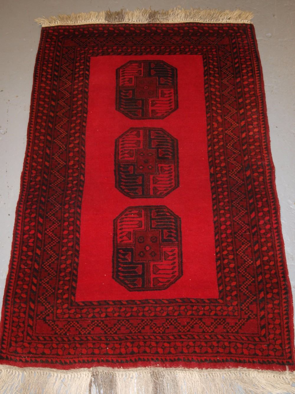 old afghan village rug bright red colour very tough hard wearing rug circa 1950
