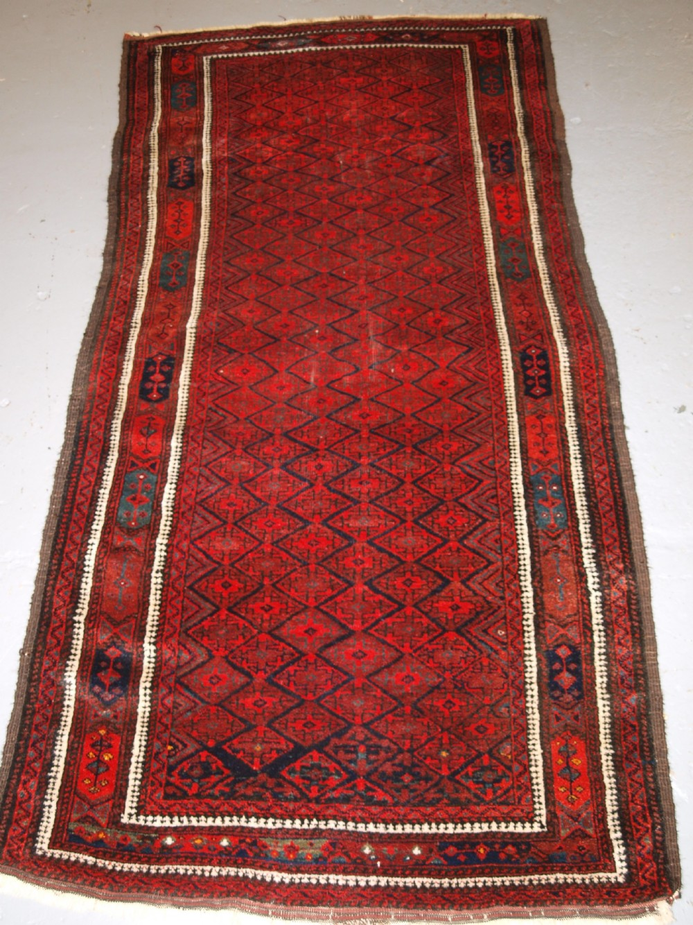 antique baluch rug with fine diamond lattice design interesting border circa 1900