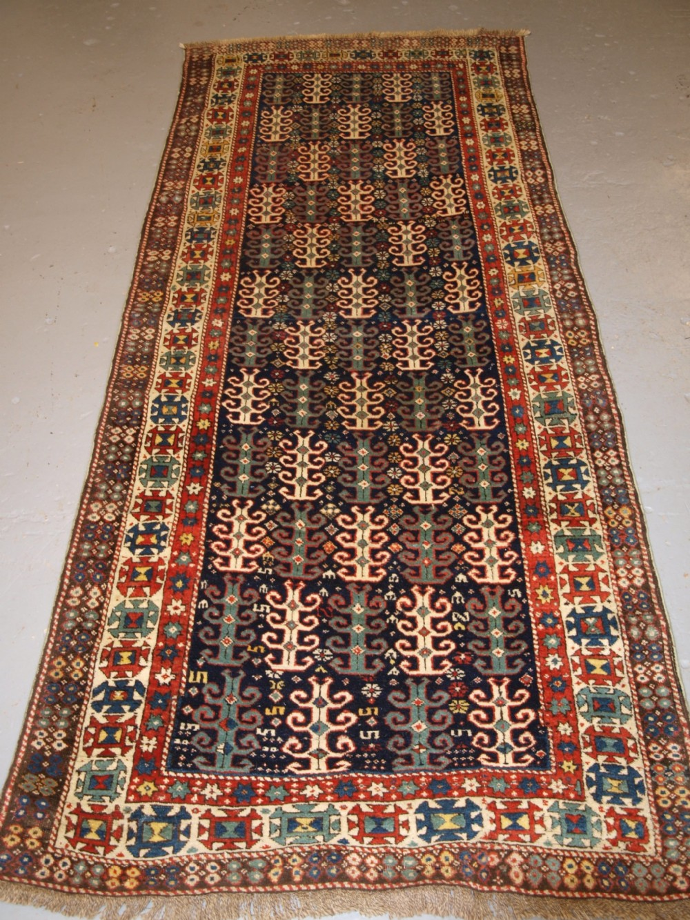 antique caucasian long rug with scarce design probably gendje region late 19th century