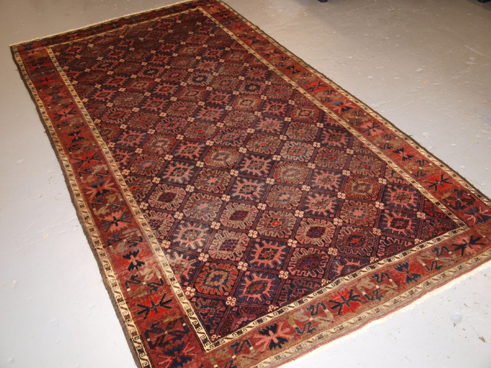 antique baluch rug with snow flake lattice design western afghanistan late 19th century