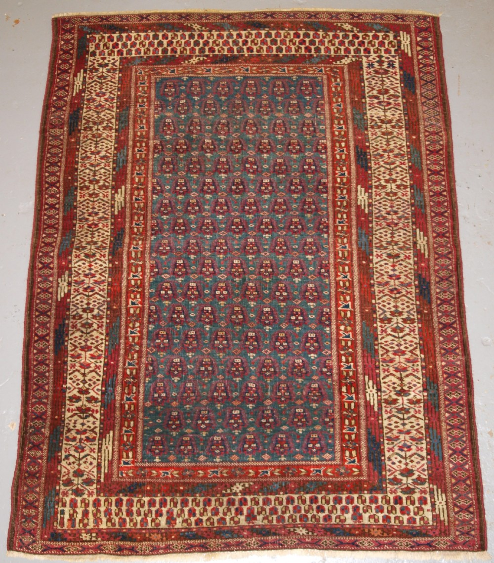 antique yomut or tekke turkmen blue ground dowry rug of rare format circa 1900