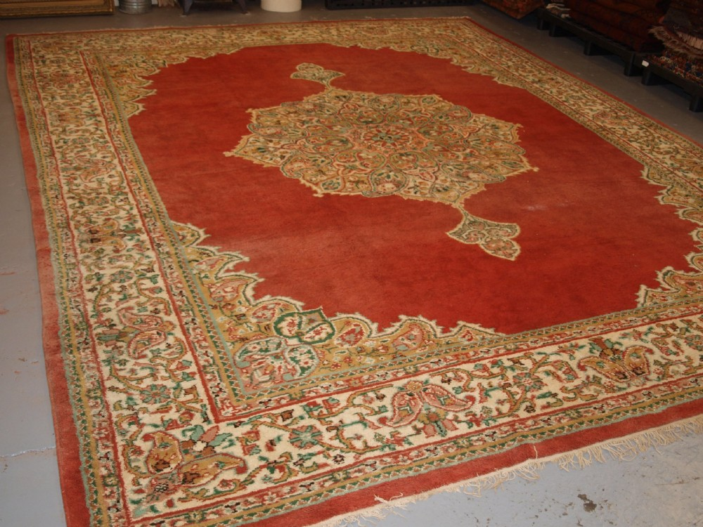 old turkish isparta carpet classic medallion design light red ground with pastel colours circa 1920