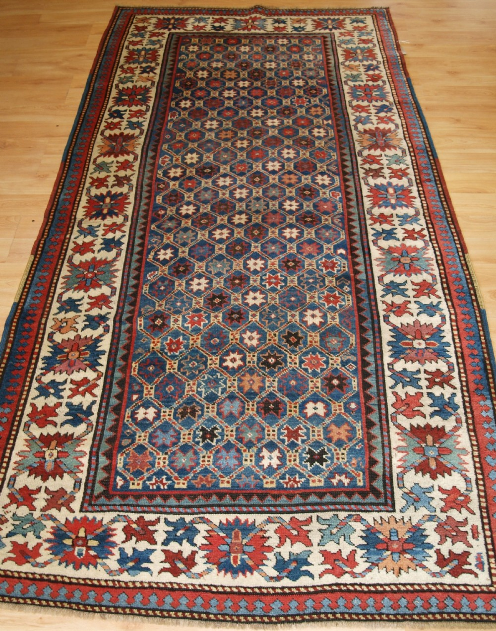 antique caucasian gendje kazak rug lattice and star design circa 1880