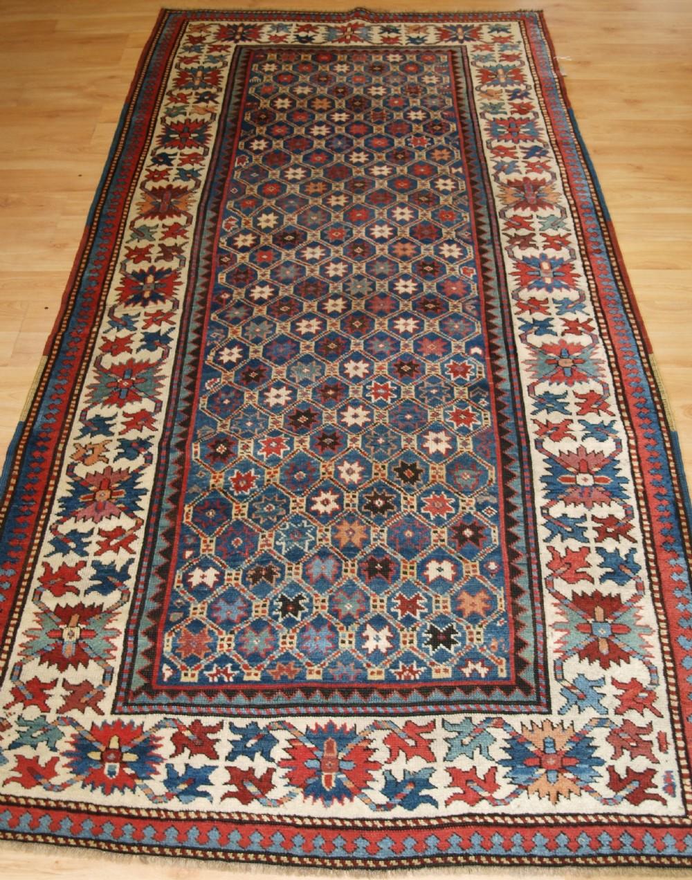 antique caucasian gendje kazak rug lattice and star design circa 1880