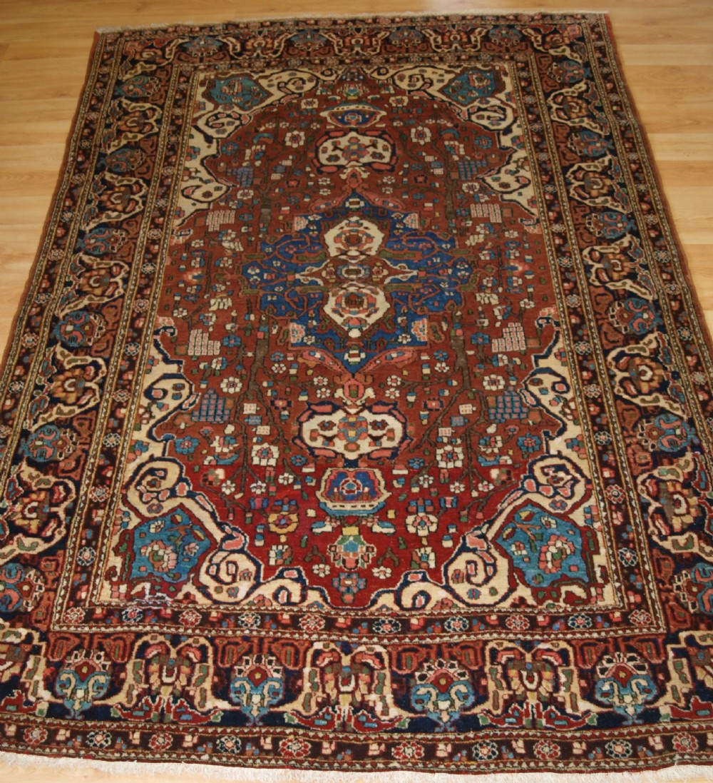 antique persian isfahan rug with small medallion good colours circa 1900