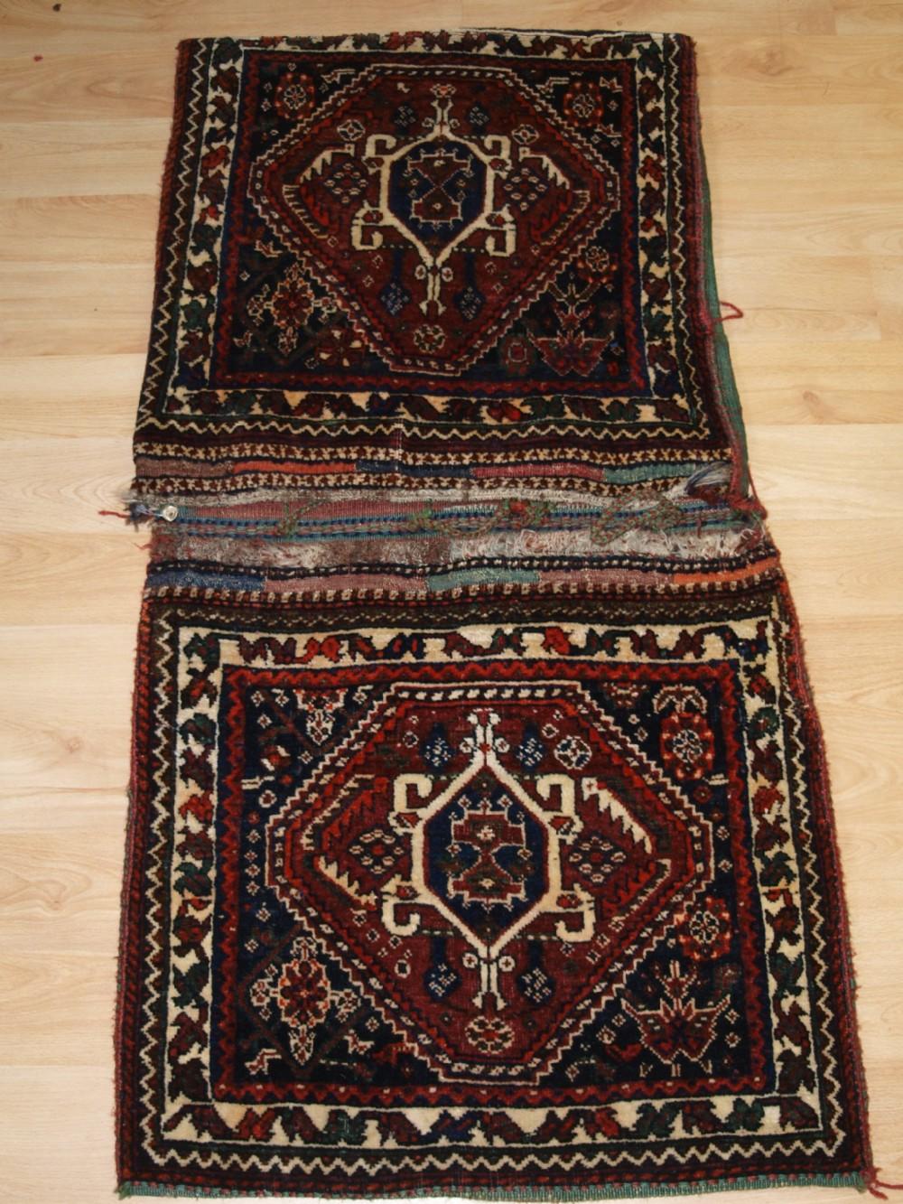 antique complete qashqai khorjin saddle bags with plain weave back circa 190020