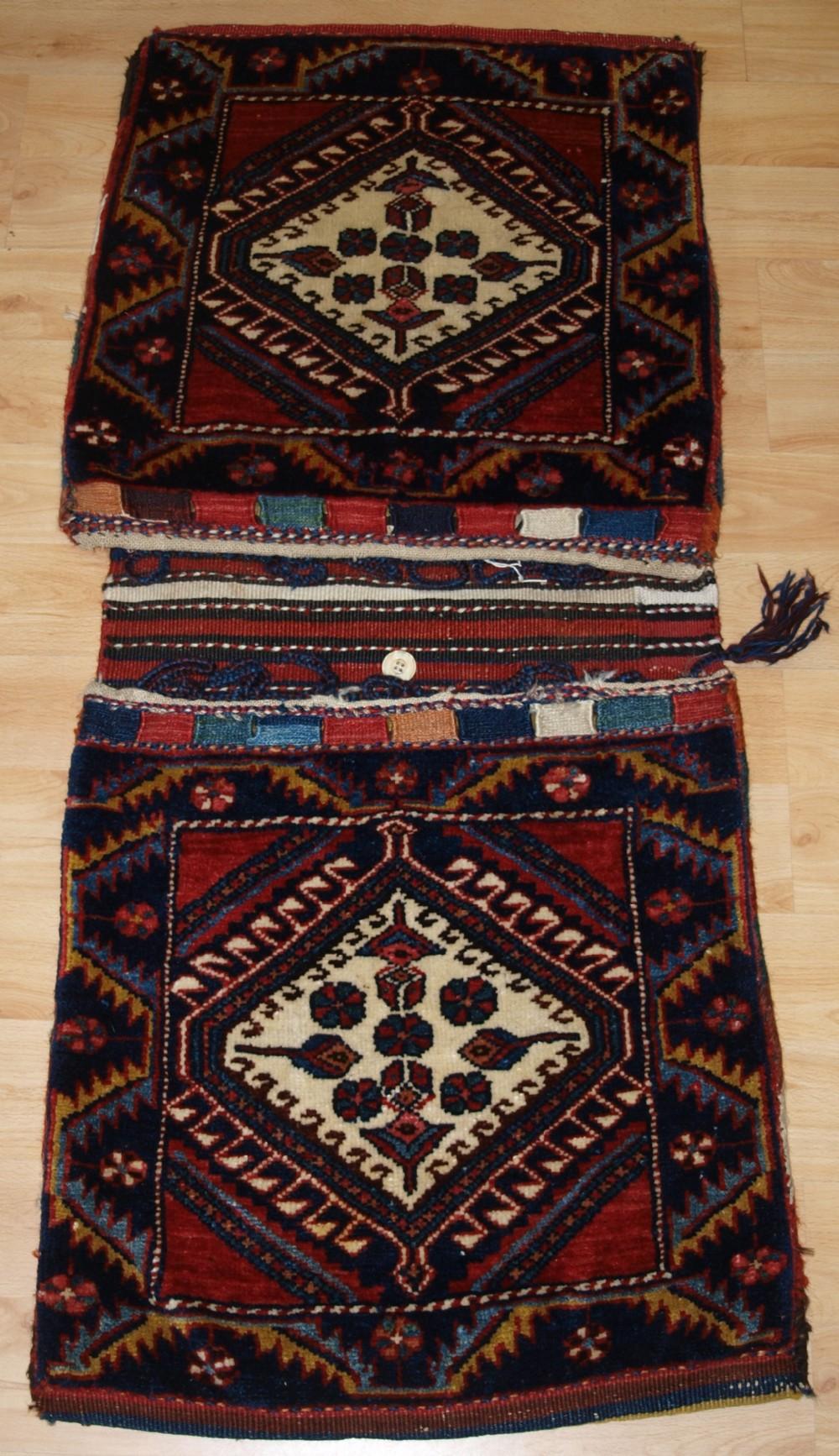antique complete luri fars region khorjin saddle bags with plain weave back circa 190020