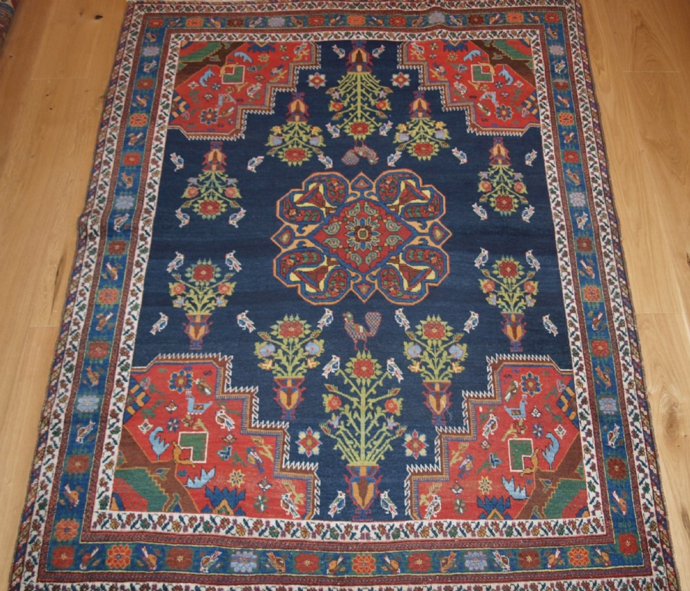antique persian afshar rug with vase design birds and flowers circa 190020