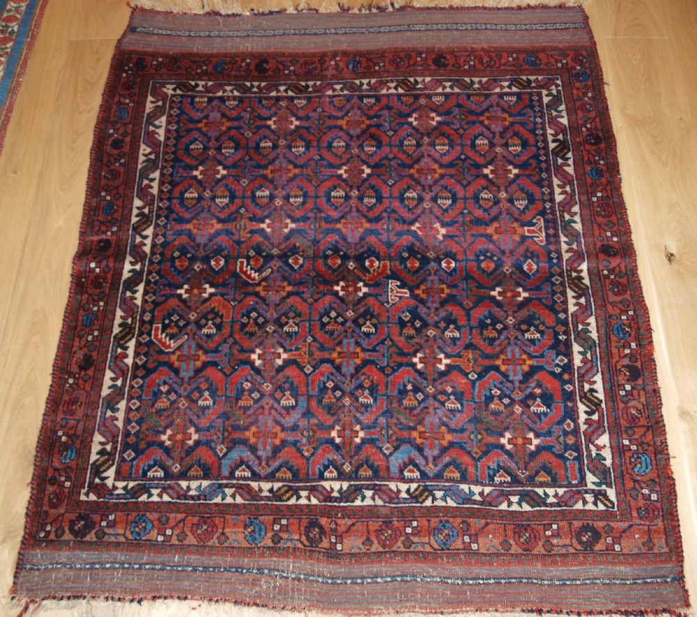 antique persian tribal afshar rug with repeat heratti design 2nd half 19th century