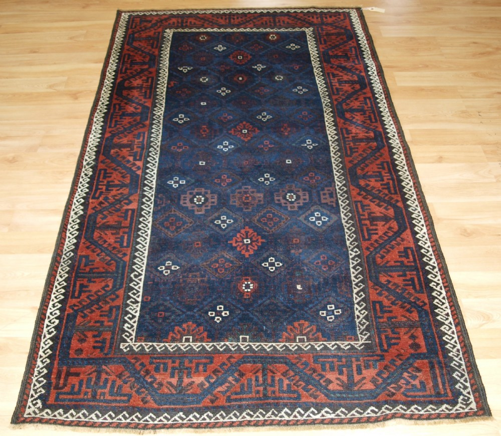 antique baluch rug with lattice design in superb blues boat border late 19th century