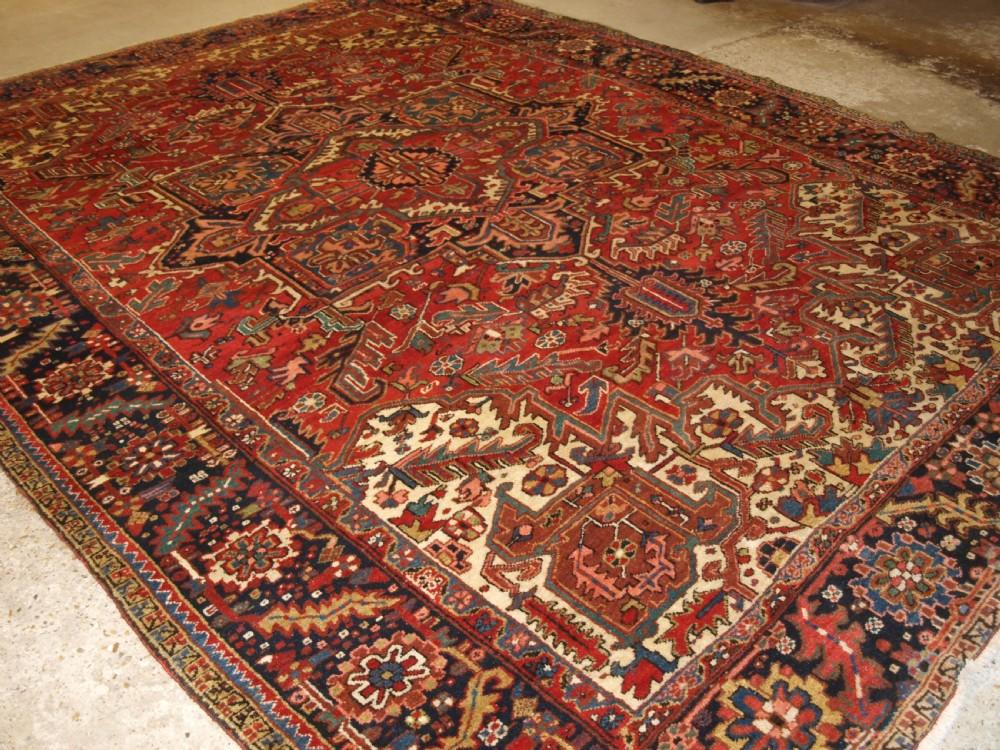 antique persian heriz carpet large medallion design red ground circa 1920