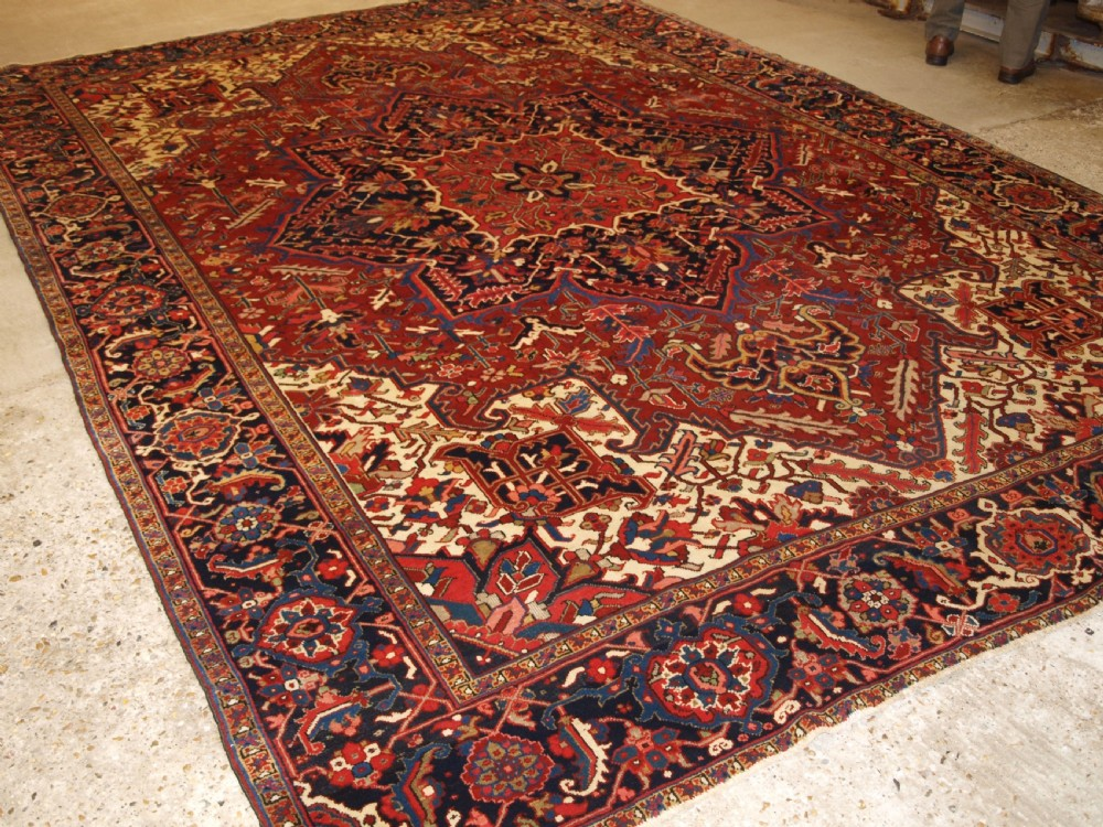 antique persian heriz carpet of good room size medallion design circa 1920