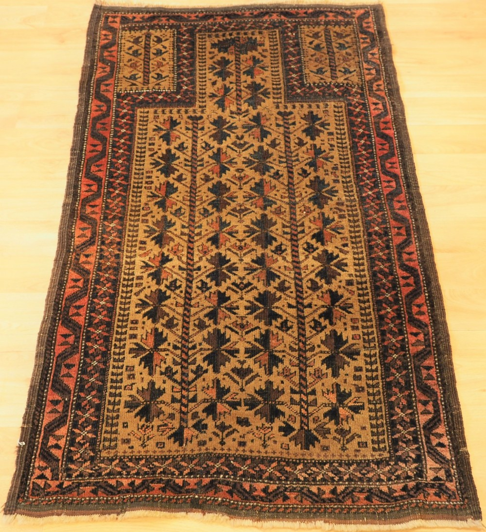 antique baluch prayer rug with tree of life design on a camel ground circa 1900