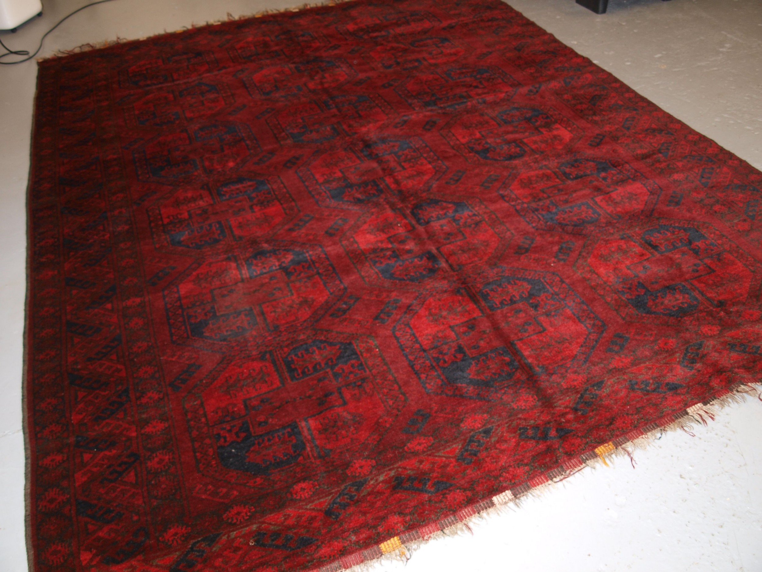 old afghan village carpet very deep red colour traditional design circa 1920