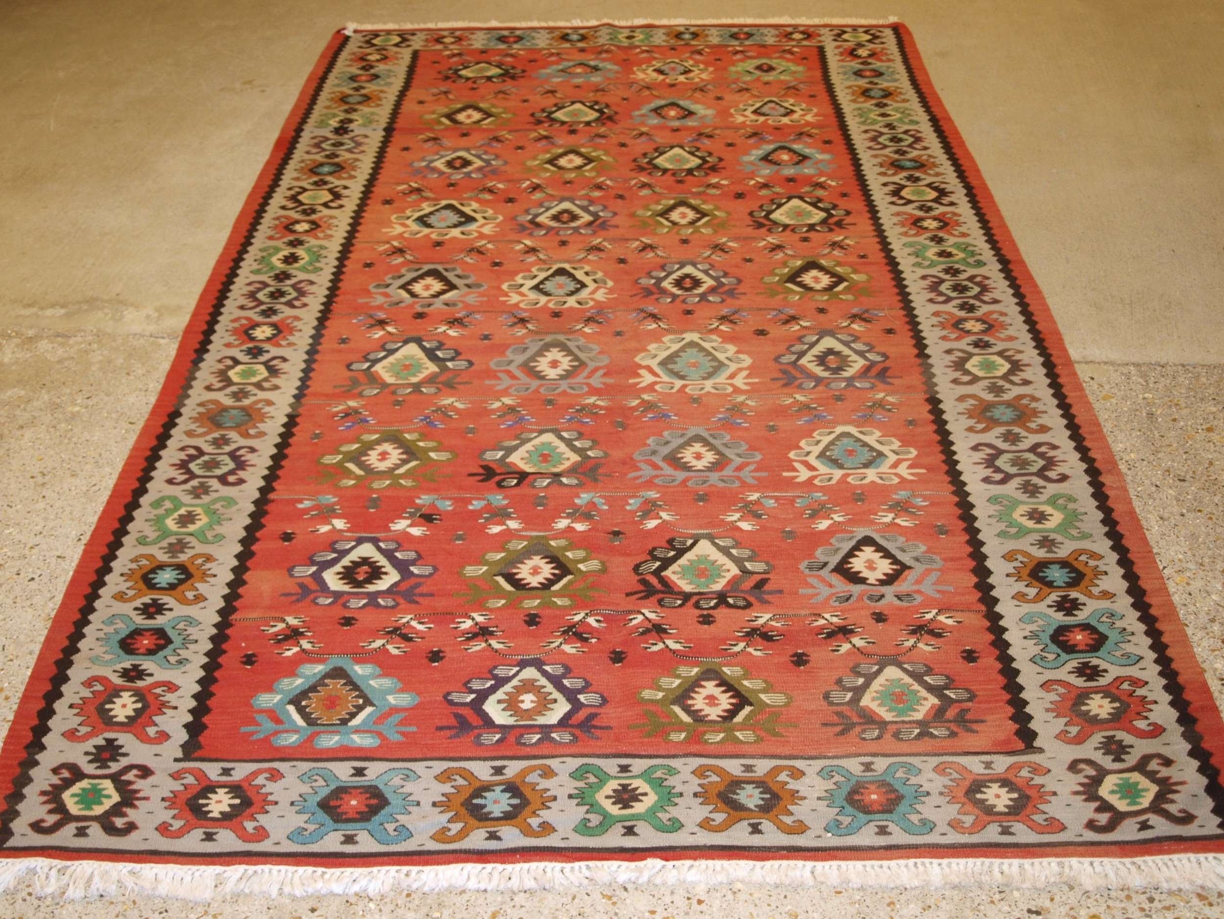 old sharkoy kilim with traditional all over design in soft colours circa 1920