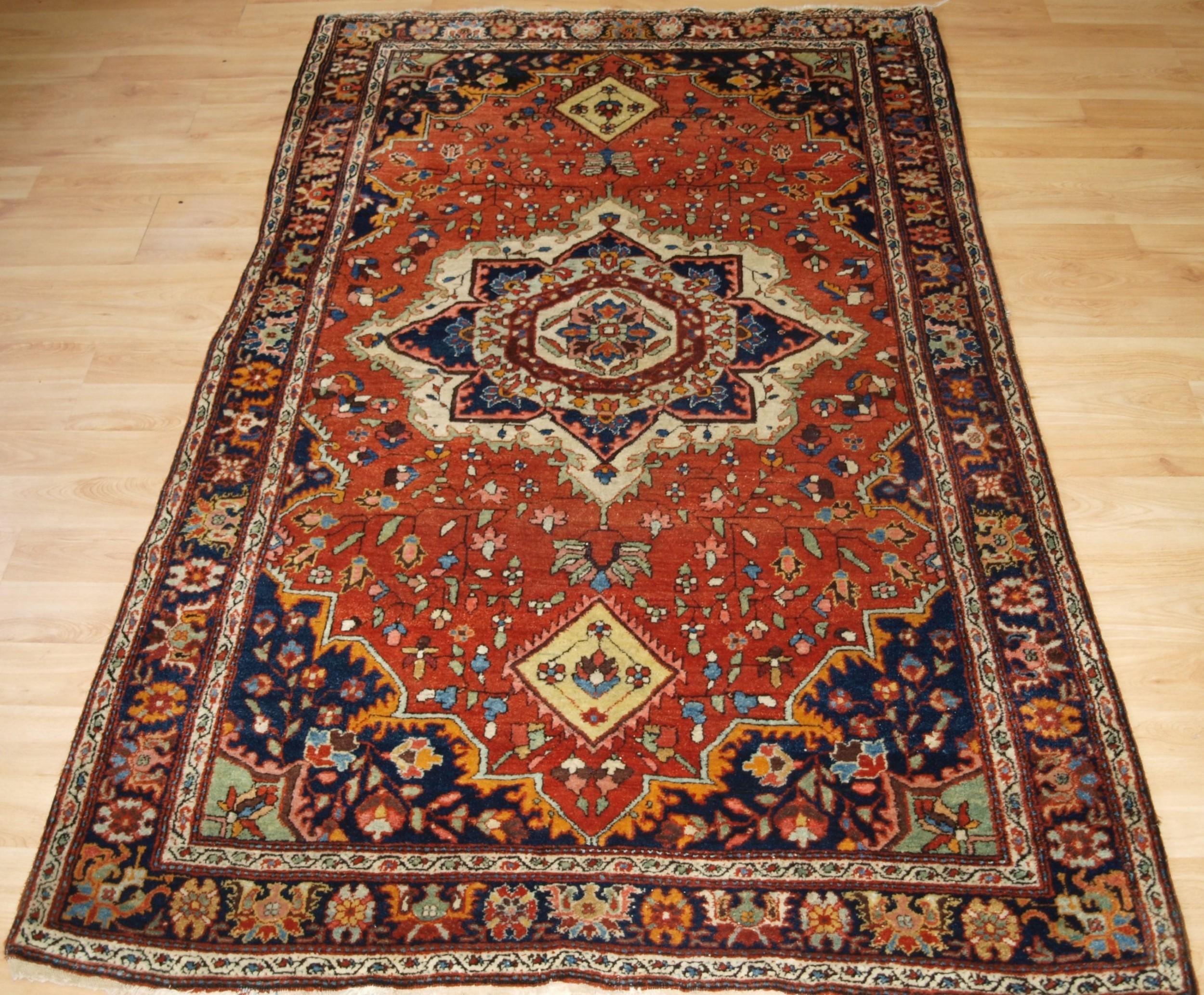 old sarouk rug with traditional design circa 1920