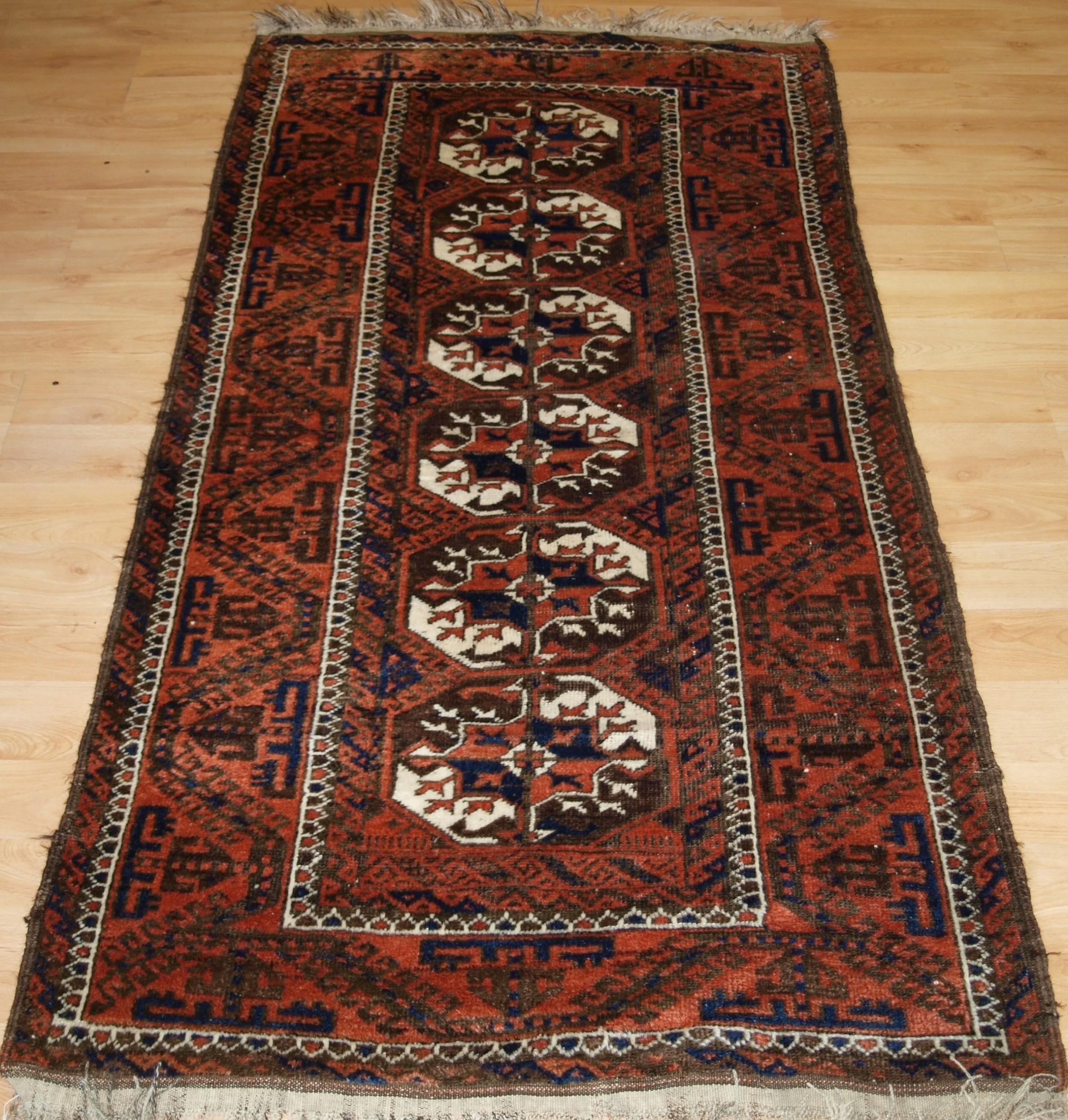 antique mahdad khani baluch rug large turkmen guls circa 1900