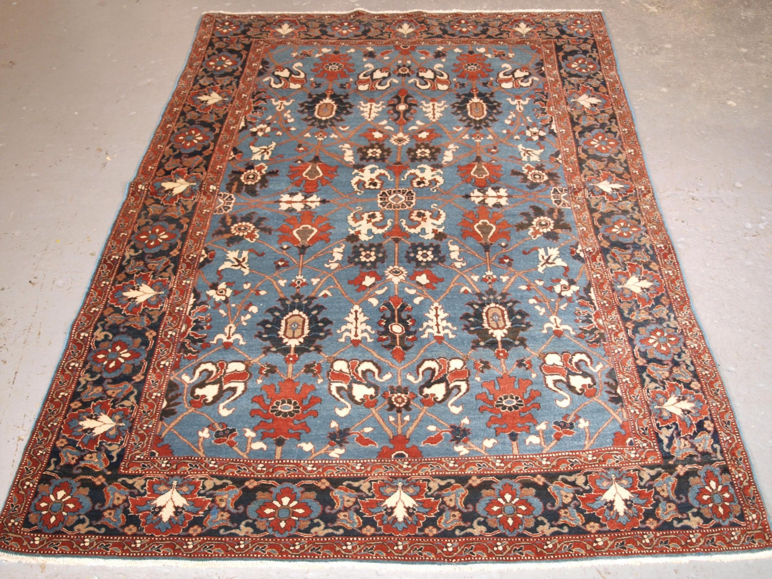 antique tabriz rug with safavid inspired vase design circa 1920