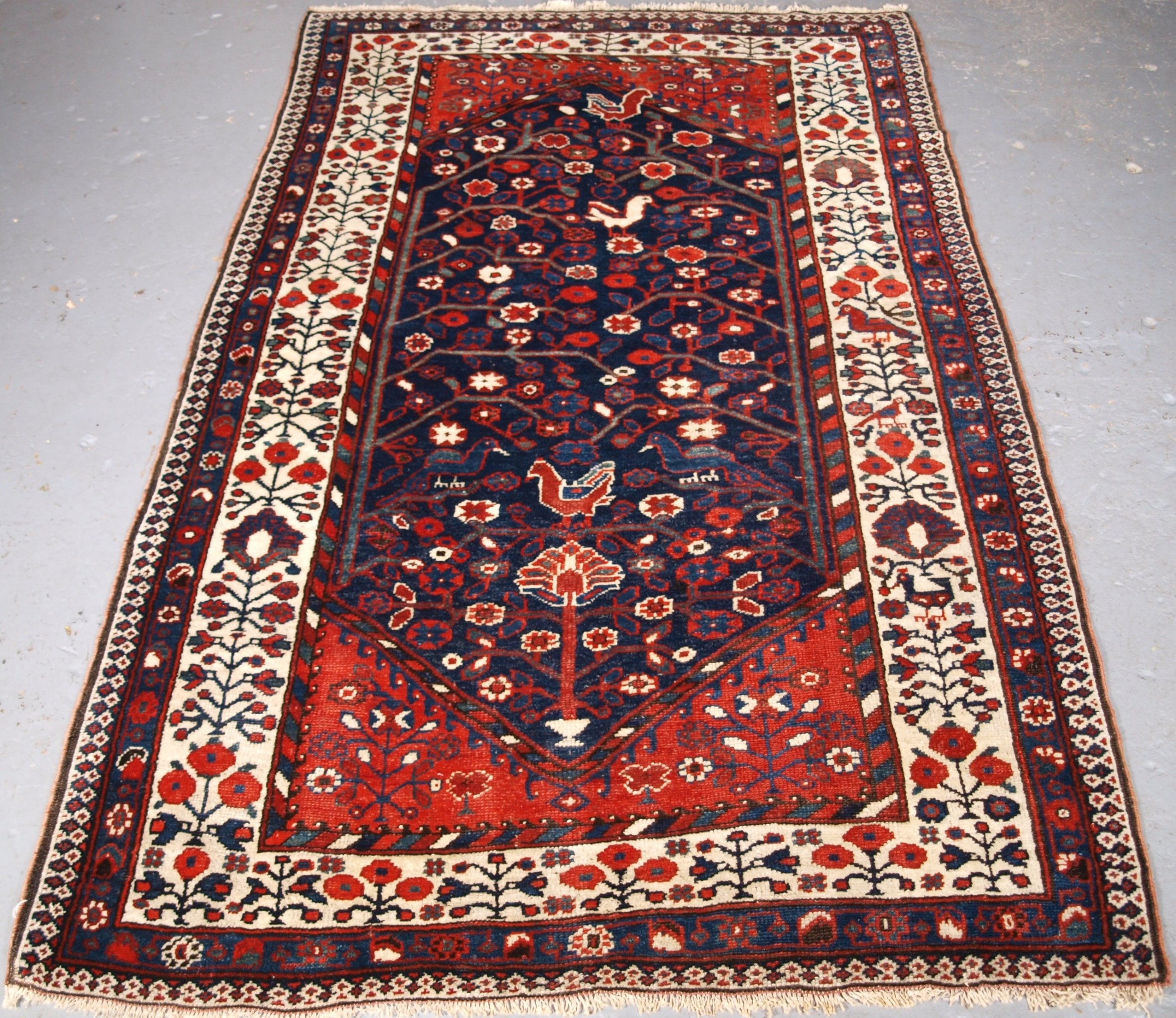antique luri rug of outstanding design flowers and birds circa 1900