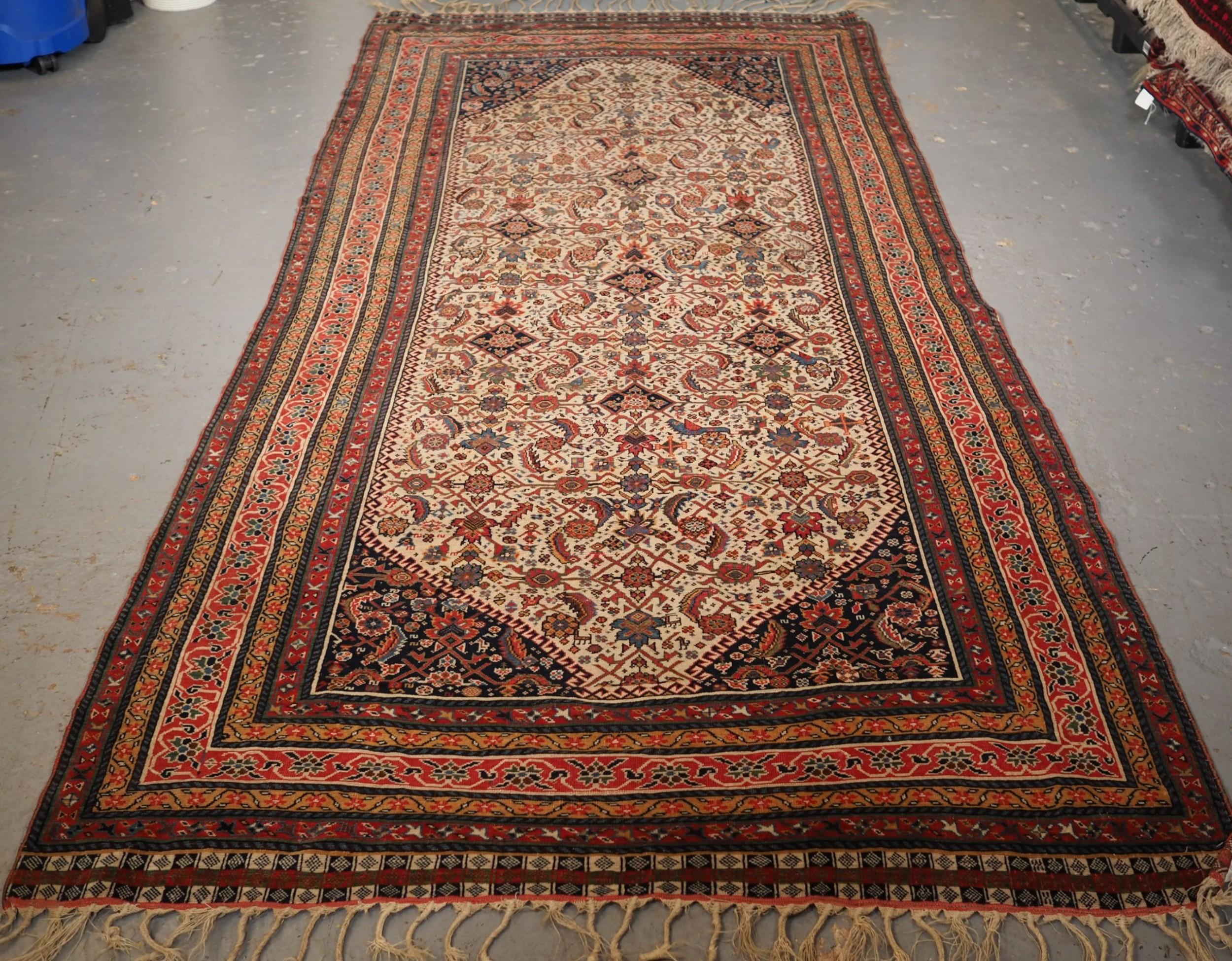 antique qashqai long rug ivory ground herati design with tibal elements circa 1870