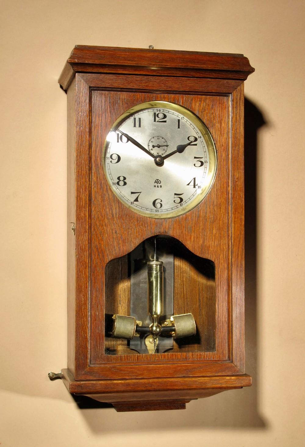 an early electrical ato haller benzing oak wall clock circa 1925