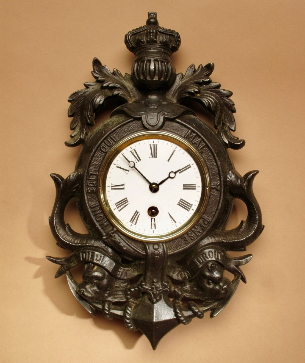 english interest a very decorative type of coat of arms cast iron wall clock