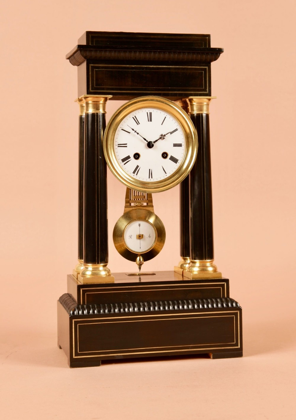 an original ebonised and brass inlayed french portico clock circa1870