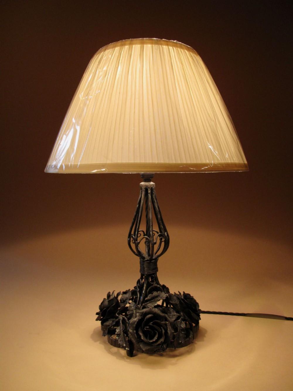a very decorative wrought iron table lamp circa 1920