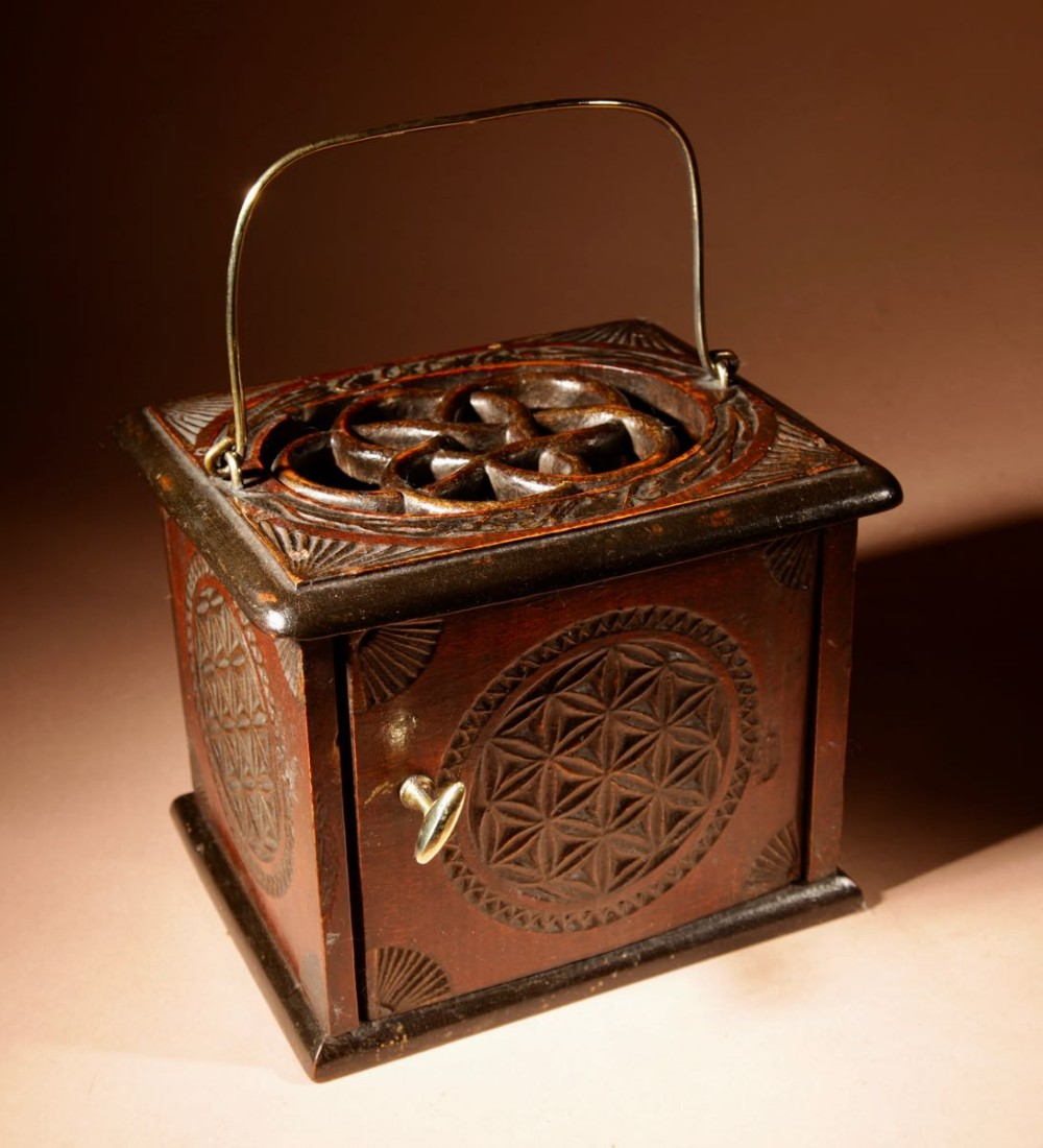 a dated dutch frisian fine chip carved hardwood and ebonised foot stove dated 1902