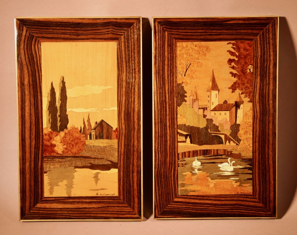 a very decorative art deco pair of signed marquetry panels circa 1940