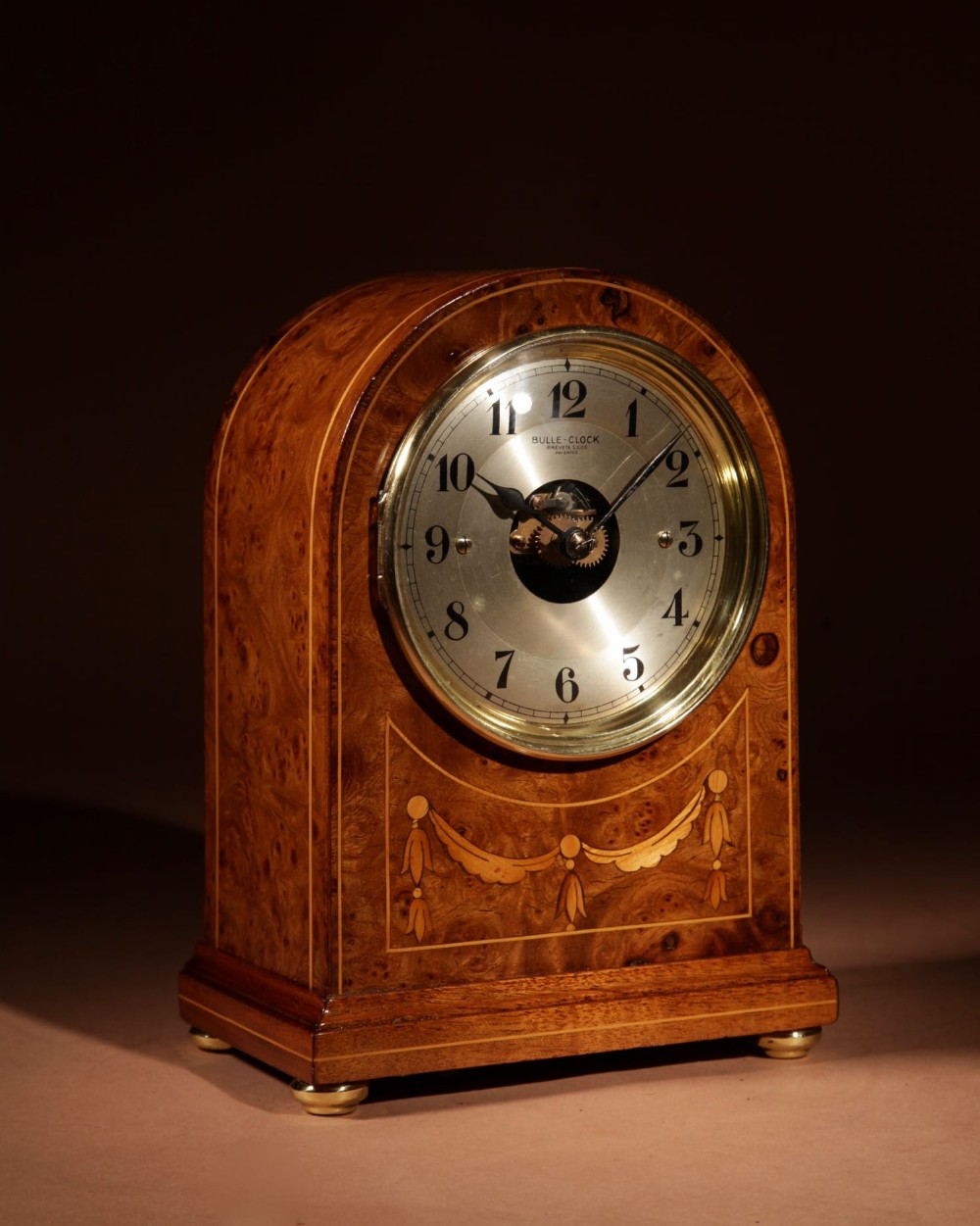 an early french original electrical bulle burr walnut mantel clock inlaid with guirlandes in satin wood
