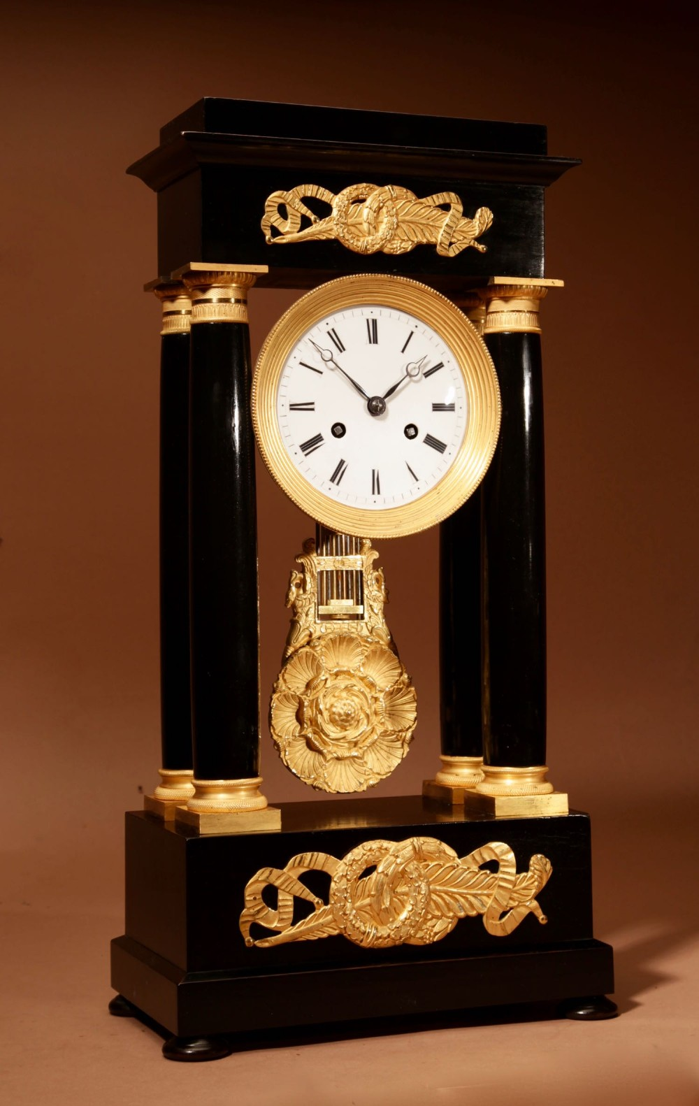 a finely made french louis philippe ebonised and ormolu portico clock circa 1840