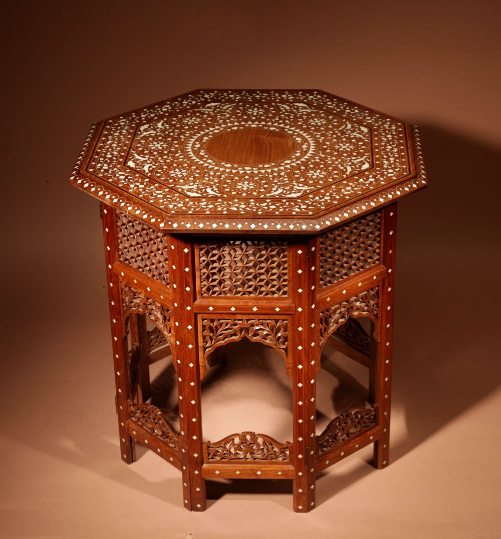a very decorative finely ivory inlayed indian hardwood folding table circa 1900