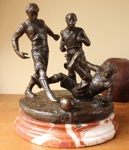 large bronze football statue