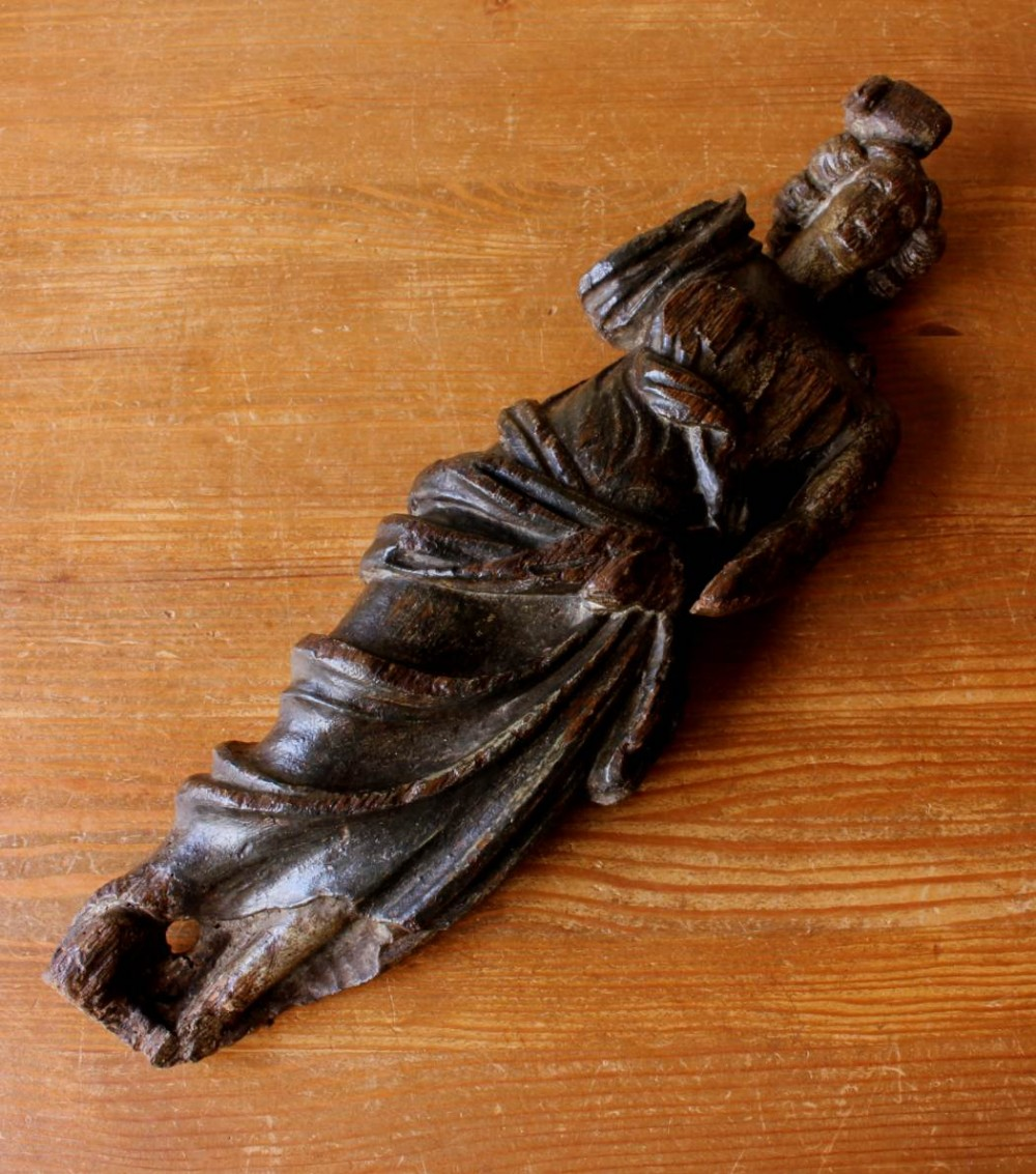 large carved wood lady statue