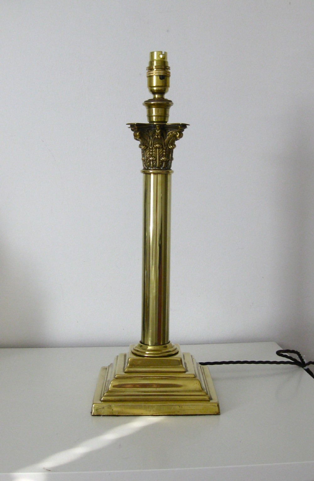 A Tall Victorian Corinthian Column Brass Lamp