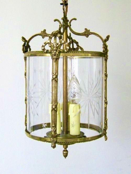 a decorative brass hall lantern