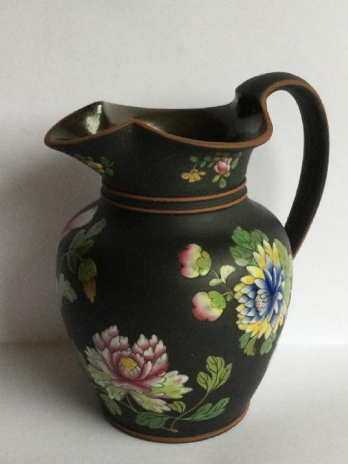 an exemplary early 19thc wedgwood black basaltes jug