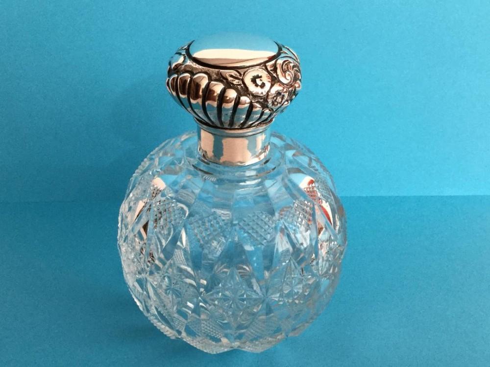 a large edwardian silvertopped perfume bottle