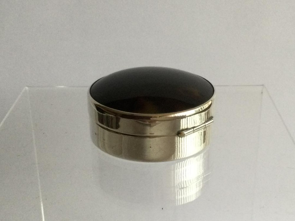 a silver and fauxtortoiseshell trinket or pill box 1920s