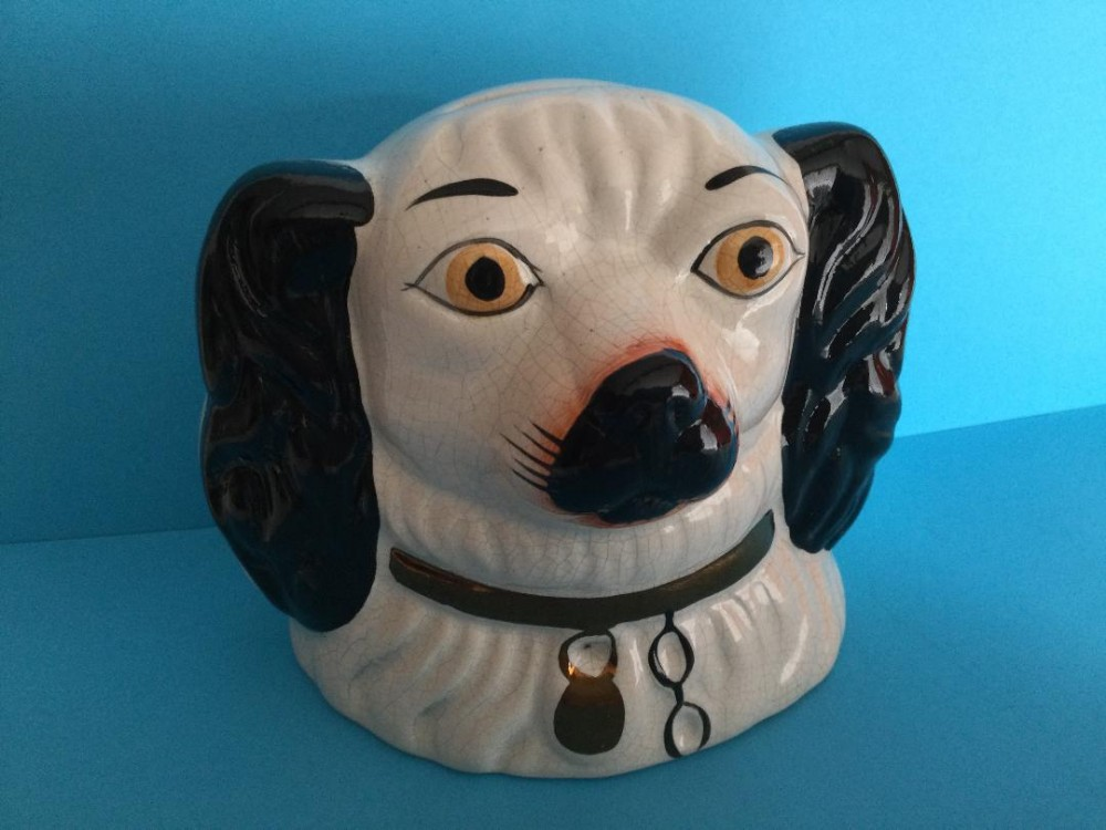 a mid victorian spaniel pottery money box