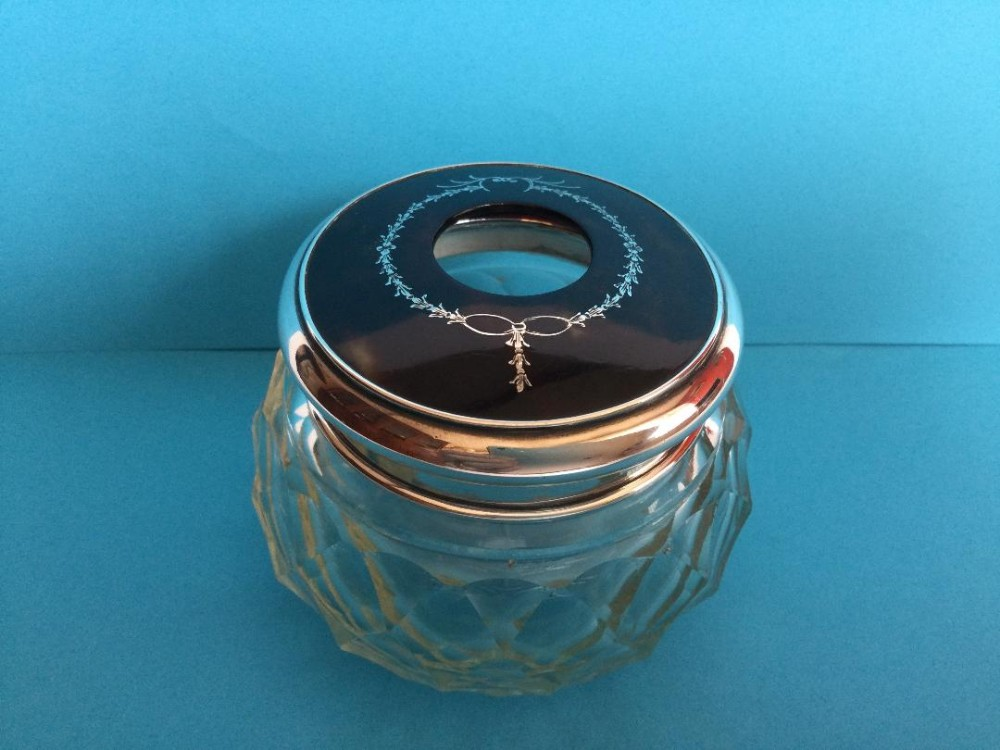 a 1920s silver and faux tortoiseshell hair tidy or trinket pot