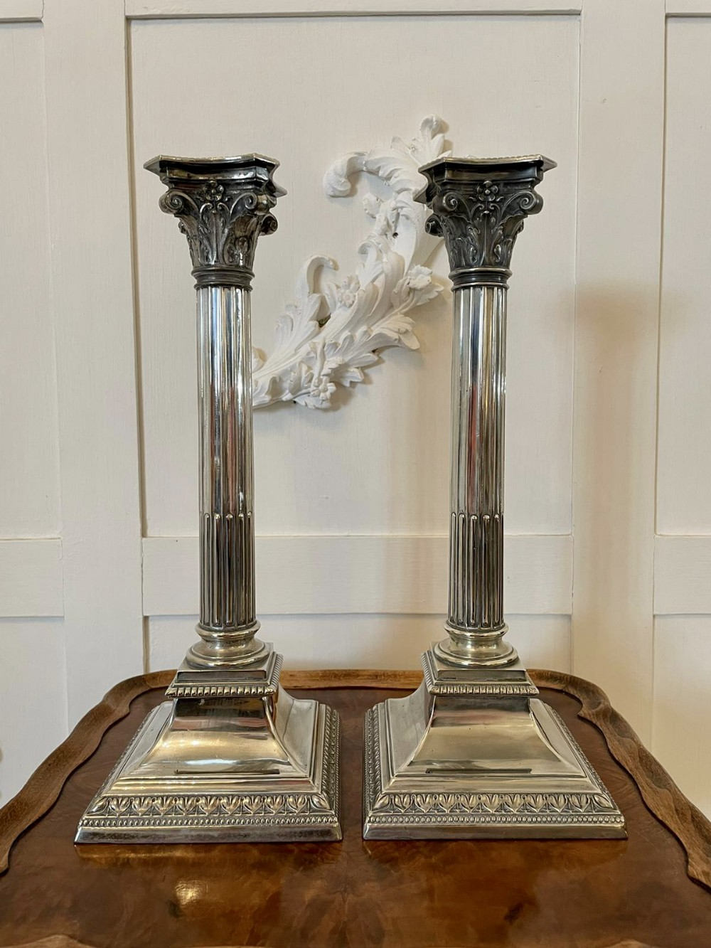 antique pair of silver plated corinthian candlesticks